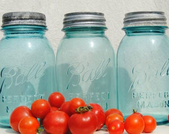 Three blue Ball Mason jars with zinc lids