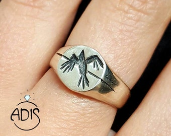 Silver ring engraved with BIRD