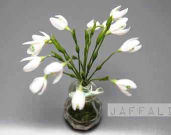 Little bouquet of snowdrops, cold porcelain, snowdrops in a vase with moss