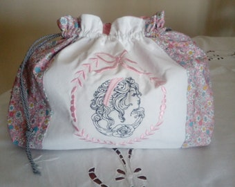 pouch has lingerie embroidered