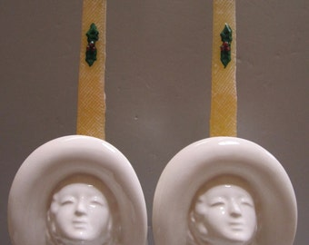 A Pair of White Art Deco Flapper Lady Head Candle Stick Holders