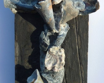 Seashells and old barn wood make this a unique Cross, sculptured from naturally broken seashells, unique Crucifix, rustic wall decor