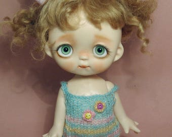 Tutu's or Blythe's handknit overall,with a hair bow