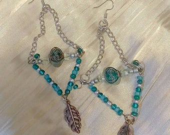 Blue and silver chandelier earrings with feather charm
