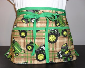 Waitress/utility/vendor apron with 3 pockets. John Deere tractors on a plaid background.