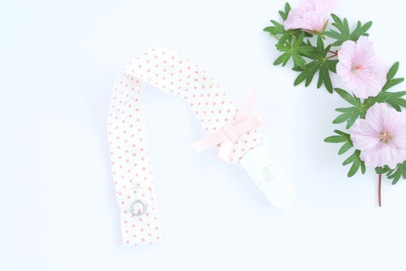 white and baby pink spot dummy/ pacifier clip with coral satin bow
