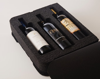 LIQUAGE 3-PK.  Travel safe suitcase foam for your wine or spirits.  Luggage for your liquid.