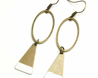 Earrings are made of silver paper
