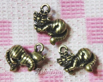 Alice in Wonderland 3D Cheshire Cat charms 5 pcs - Antique bronze