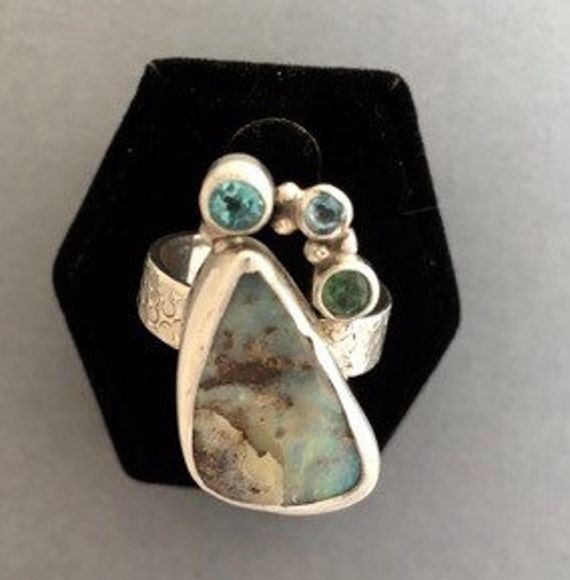 Beautiful boulder opal apatite and topaz ring