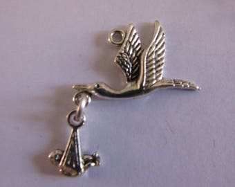 2 silver charms stork with baby