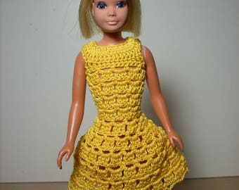 a pretty and lacy dress with a flared skirt done in yellow