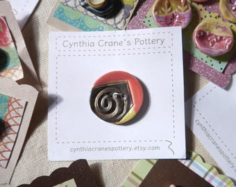 Large Round Clay Button, Metallic Bronze, Red and Yellow Glazes