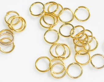 100 Gold Tone 6mm Jump Rings  F117