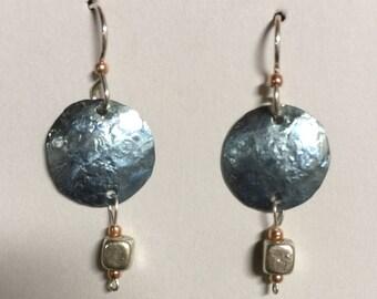 Titanium dangle earrings in blues.  On sterling earwires.