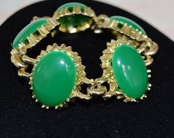 Vintage Bracelet in Gold Tone Metal with Green Plastic Cabochons