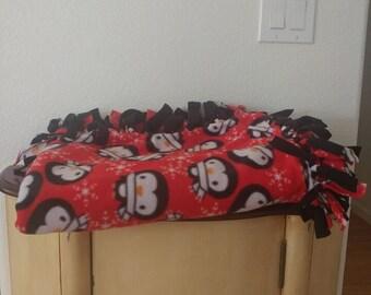 Blanket Red and black fringed penguin design
