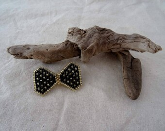 Black and gold bow brooch