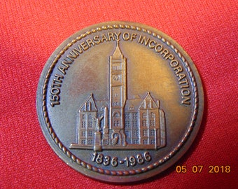 """One (1), 1 1/2"""", Diameter, 150 th. Anniversary of Incorporation, City of Lowell, MA., 1836-1986  Medallion."""