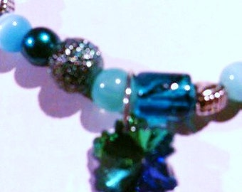 Teal and sterling braclet with australian crystal clover.
