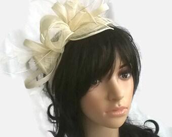 Ivory Feather Fascinator..stunning  rosette fascinator on a headband