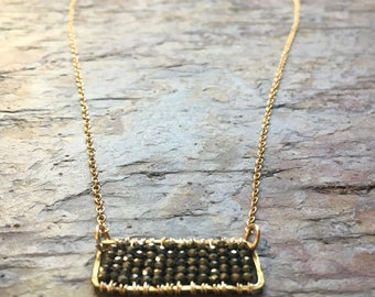Gold pendant  necklace with pyrite gemstones