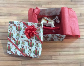 Miniature Toy Rocking Horse in a Holiday Gift Box with a Red bow on top