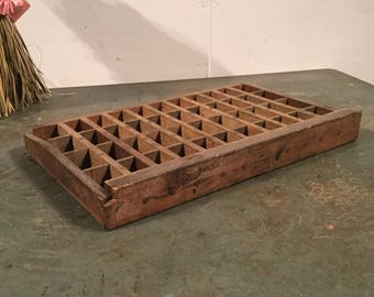 Vintage wooden storage trays for printing press letters