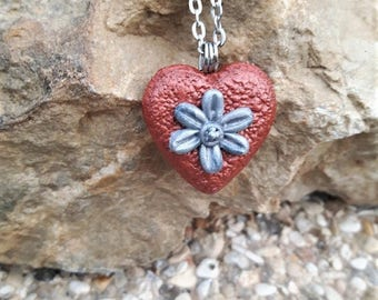Heart Necklace copper with a Fimo flower.