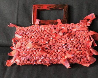 red clutch handbag, custom knitted with 100% cotton, black handles, lined with 2 inside pockets, 3 snaps to close