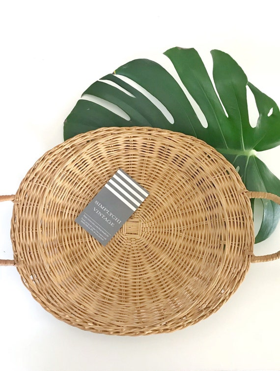 woven straw rattan wall basket with handles | serving tray