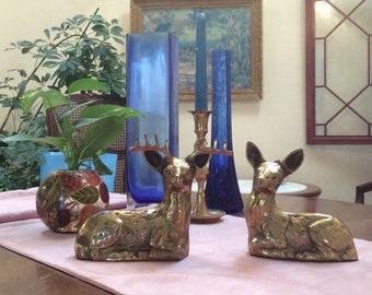 Solid brass deer figurines