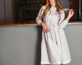 Romantic elegant knee length, long sleeve woolen dress in light colors with cotton lace, pearly buttons and belt.