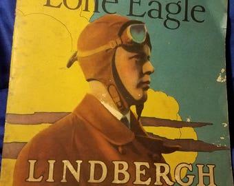 The Lone Eagle Charles Lindbergh 1929 colored booklet describing the Spirit of St. Louis 1st trans-Atlantic plane crossing true survivor