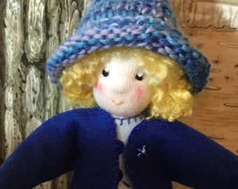 elf doll, bendy doll in blue jacket, sparkly skirt and knitted hat