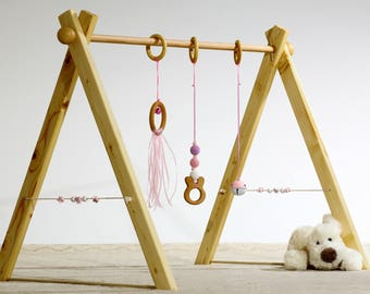 Portico of awakening, baby gym, light pink version, 3 rattles, spheres in wood on the sides.