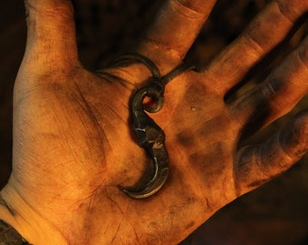 A hand forged claw pendant. Comes supplied with a high quality elk leather thread.
