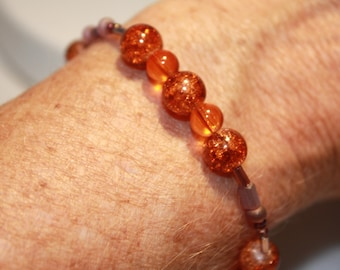 Beautiful Orange & Purple glass bead bracelet