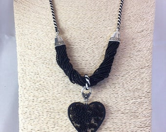 Necklace twisted beads and ornate black wooden heart, silver metal