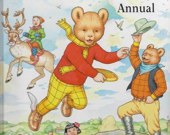 The Rupert Annual No. 64, stories by Ian Robinson and illustrated by John Harrold.