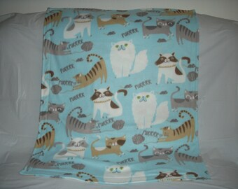 Kitty Blanket - cute little purrrring kitties on light blue fleece with the same pattern on the reverse side.