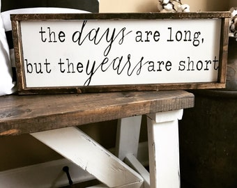 The days are long but the years are short wooden sign