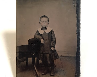 Tintype of a Frightened-Looking Boy in a Dress, 19th Century Antique Photograph