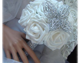 bouquet of white, with a silver butterfly and a rhinestone wrist