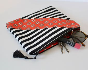Black and White Stripe Pouch with Orange Accent and Tassel Detail; Zipper Closure; Cosmetic Bag; Clutch; Purse Organizer; Makeup Bag