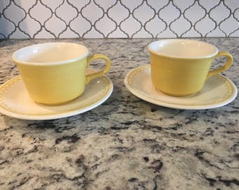 Vintage pair of yellow tea cup snd saucers