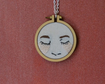 Embroidered necklace of a girl crying peach tears