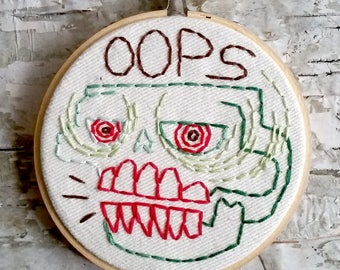 "green & red OOPS skull - 4"" hand embroidered wall hanging"