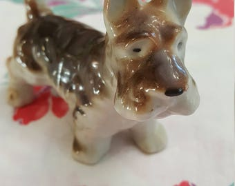 Vintage made in Japan Scottish Terrier with brown and grey coat tail held high