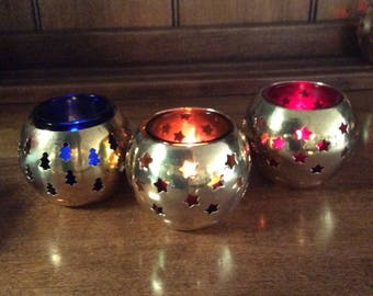 6 Brass candle holders with colored glass votive inserts